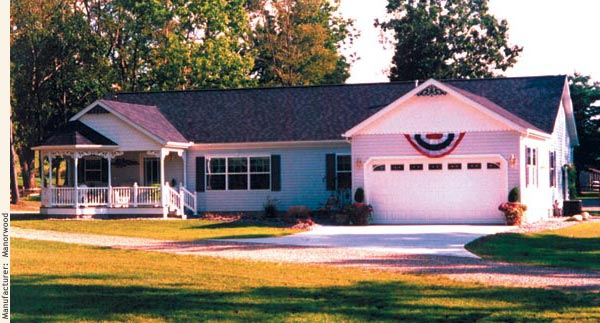 A modular home one-story ranch with a front facing two-car garage, porch, and gazebo.
