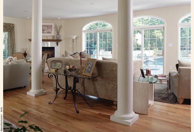 Classic Greek columns create a generous open living room with three double french doors and eliptical windows.