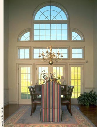 A huge palladian window over two double french doors adds light and elegance to the dining room.