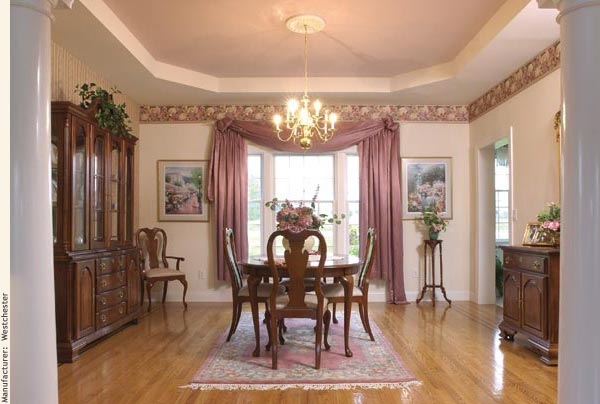 A formal yet welcoming dining room with a tray ceiling