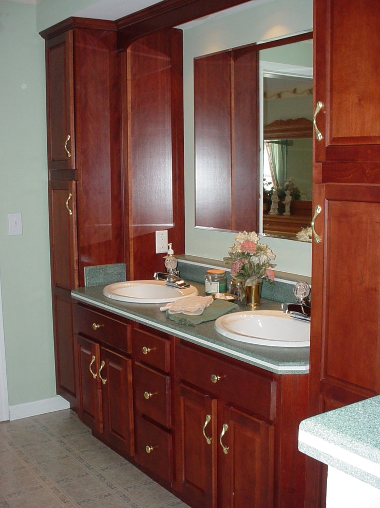 Modular Home Master Bathroom With Cherry Double Vanities And Linen Cabinets