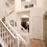 Modular Home Stairs with Balcony in Two-Story Vaulted Foyer