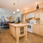 Modular Home Galley Kitchen with Island and Maple Cabinets