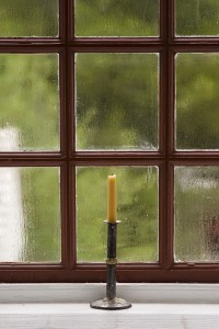 Moisture condensation often forms on the inside of windows and doors in new homes because of the drying out of the lumber and concrete foundation.