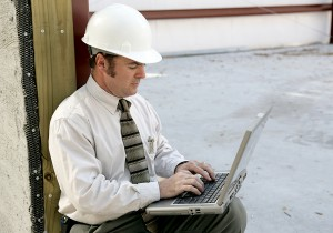 An inspector using the checklists on his computer to carry out his responsibility for modular home building code enforcement