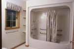 Universal desgned modular home tub - shower with grab bars and seat