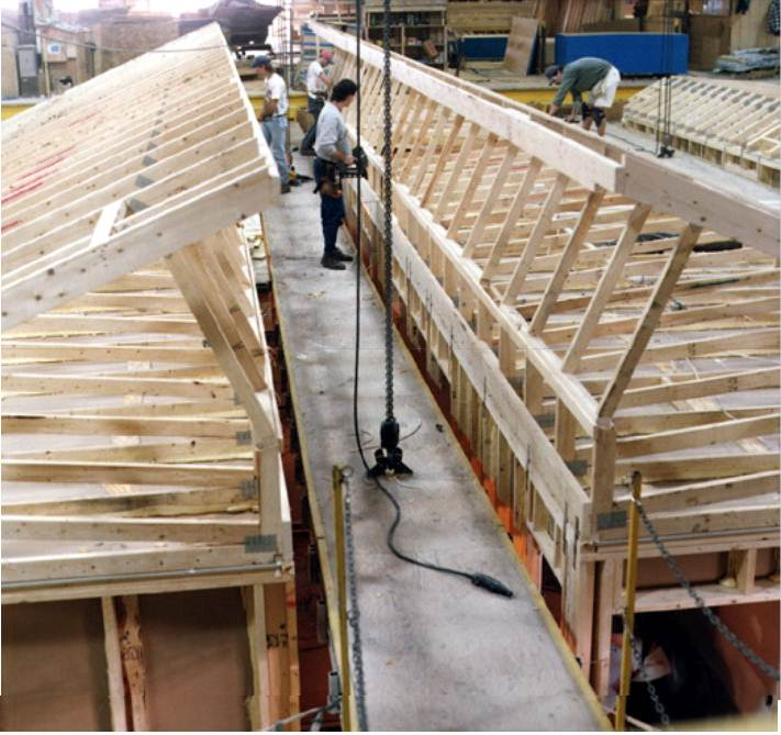 A modular home being constructed on the factory's assemply line. You can learn a lot about a dealer's and factory's modular home quality by viewing a home after it comes off the assembly line and before it is delivered to its destination.