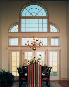 A vaulted ceiling along with a Palladian window lends an air of majestry to this dining room.