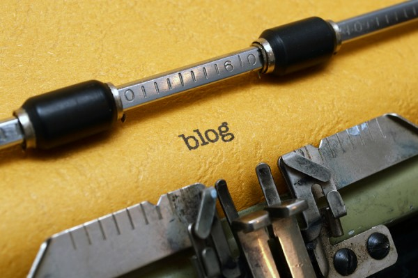 The word blog on a yellow paper in a conventional typewriter