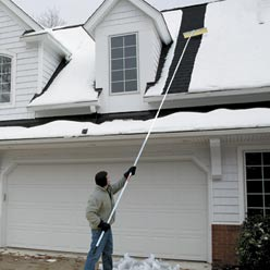 Use a snow rake with a long handle to safely remove snow from your roof.