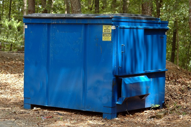 The best option for managing trash removal on the site is to use a dumpster.