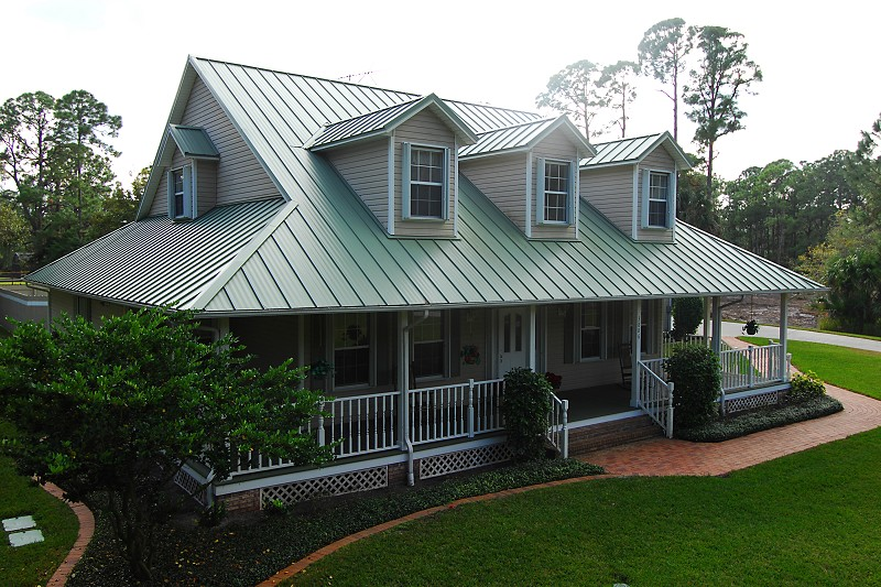 Metal roofs are attractive durable green energy efficient for Images of houses with metal roofs