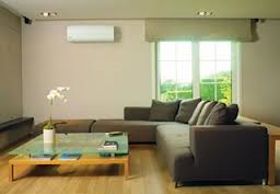 The air handler in the living room for this mini-split heating and cooling system is hung on the wall.
