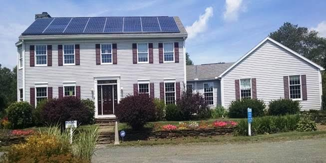 The Home Store's two-story model home with solar panels installed by Tesla Solar.